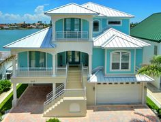 I love this Florida Keys home.  The color scheme is perfect for the tropics!