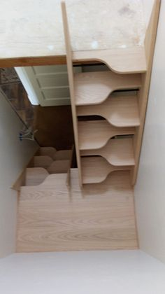 Take a look at this space-saving alternating-tread stairway we just built. We'd love to build one for you. Give us a call at