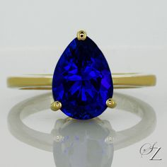 A beautiful Tanzanite pear, glowing with a mesmerizing deep blue hue set as a solitaire in yellow gold. Very beautiful and timeless. Sapphire Jewelry, Gemstone Jewelry, Tanzanite Rings, Rare Gemstones, Solitaire Ring, Gemstone Colors, Deep Blue, Ring Designs, Blue Sapphire