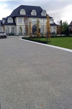 Top 50 Best Concrete Driveway Ideas Front Yard Exterior Designs is part of exterior Ideas Driveways - From simplistic entrances to highend mansion constructions, discover the top 50 best concrete driveway ideas Explore front yard exterior designs