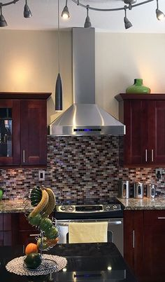 Beautiful Red toned Kitchen featuring the PLJW 130 Stainless Steel Wall Mount Range hood from Proline sent to us from one of our customers. View our Vent Hood Selection: prolinerangehoods. Kitchen Vent Hood, Warm Kitchen, Kitchen Stove, New Kitchen, Kitchen Decor, Kitchen Range Hoods, Kitchen Cabinets To Ceiling, Kitchen Backsplash, Backsplash Design