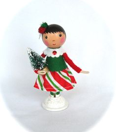 This adorable little clothespin doll is 4 1/2 inches tall. It is hand painted with acrylic paint and sealed with a gloss varnish. The clothes