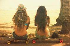 Skate longboard swim suit long hair best friend red wheels yellow wheels sidewalk surfing shorts