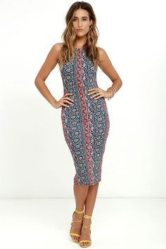 Hit the shops in casual style in the Kiss the Sky Navy Blue Print Midi Dress! Stretchy knit with a climbing floral and paisley-inspired pattern (in shades of coral red, peach, and mint) shapes this figure-hugging midi dress. Rounded halter neckline, open back, and slender straps complete the look.