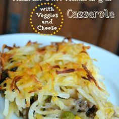 Hashbrown Hamburger Casserole with Veggies and Cheese Recipe Main Dishes with olive oil, onions, lean ground beef, flour, ketchup, beef broth, worcestershire sauce, salt, pepper, frozen mixed vegetables, hash brown potatoes, shredded cheddar cheese, butter