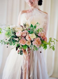 Dahlia, lamb's ear, ranunculus, and rose wedding bouquet: http://www.stylemepretty.com/2016/12/15/the-best-bouquets-of-2016/ Photography: Jose Villa - http://josevilla.com/
