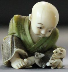 Ivory Shibayama netsuke with Sesshu Signed Yasu Yuki. Depicting the famous painter Sesshu as a boy at the Sokokuji temple, the seated figure bound with ropes being gnawed by a small rat . Signed on the bottom in inset tablet Yasu Yuki Tokyo school Size 27mm high- 25mm wide. 19th C