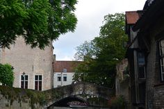 Look closely at the building on the left. That is Bruges' smallest window! Be sure to ask a local for their story about why it is so tiny. I was told at least three different tales. Stuff To Do, Things To Do, Small Windows, Bruges, Great Photos, Amsterdam, At Least, Mansions, House Styles