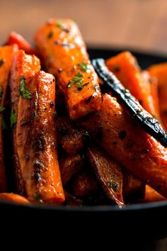 "These are based on Suzanne Goin's turmeric-spiced root vegetables from her wonderful new book ""The A.O.C Cookbook."" I use her technique for roasting the carrots, and use the same spices she uses, but I make the dish with a little less olive oil and butter to cut down on calories Suzanne serves her mix of carrots, turnips, parsnips and rutabagas with Greek yogurt seasoned with kaffir lime juice and zest, and mint chutney"
