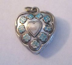Sterling silver forget-me-not flower heart charm.