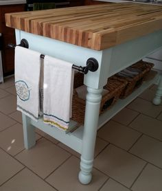 The cutest little butcher block island!  Perfect for a tiny starter home