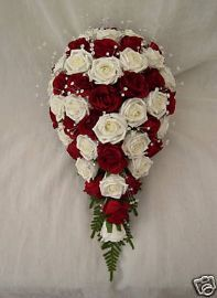 Bride's wedding bouquet with Red and Ivory Roses.