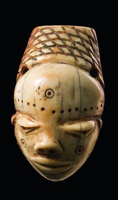 "Africa | Anthropomorphic amulet mask ""ikoko"" from the Pende people of DR Congo | Ivory; shiny patina"