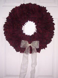Three to four yards of fabric, cut into 3 inch squares and some fabric glue makes for a pretty wreath.  You can actually do this for all seasons...not just Christmas.