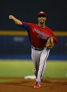 Nelson Figueroa of Puerto Rico pitches against Venezuela during the first round of the World Baseball Classic at Hiram Bithorn Stadium on March 2013 in San Juan, Puerto Rico. World Baseball Classic, Wbc, Pitch, Puerto Rico, Baseball Cards, Sports, Closet, Venezuela, Hs Sports