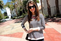 Black and white striped top with pink statement necklace