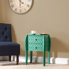 This emerald green chair side bombe chest with its contemporary on trend quatrefoil pattern makes any room have just the right amount of trend appeal.