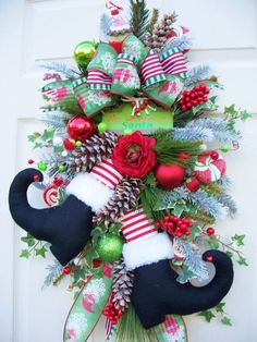 Christmas Santa boot swag  http://www.timelessfloralcreations.com/