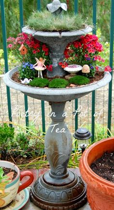Fairy Garden in a non-working two-tier fountain - this is a wonderful look! I can see trailing plants creating a secretive space, or perhaps something jungle-y below - Poetry In A Pot Of Tea: Moss and Mushrooms