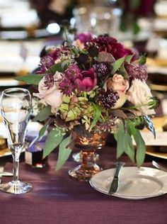 Beautiful for a late fall wedding. Viburnum and unripe blackberry sub would also be gorgeous. Flowers in arrangement: Antique hydrangea and roses, plum scabiosa, astrantia, tulips, dahlias, and seeded eucalyptus