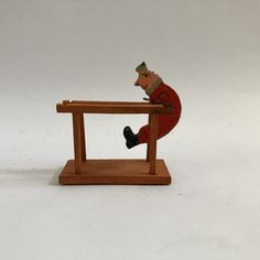 miniature vintage tumbling acrobat on base in the Erzgebirge hand painted style, old German kinetic small balancing clown toy figure