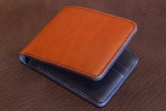 Handmade bifold wallet. Wickett & Craig Chestnut Bridle leather outside with Horween Parisian Blue Essex leather inside.