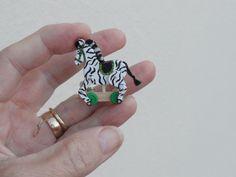 Moving Zebra.  By Lynn of Miniatures perfectly small. https://www.etsy.com/shop/LynnJowers?ref=hdr_shop_menu