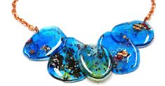 These resin shapes are a happy accident.   In my studio they were referred to as the blue experiment.   My project began with an odd i...