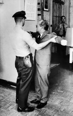 """Author Truman Capote getting frisked before visiting murderer Perry Smith for info regarding his book """"In Cold Blood"""""""