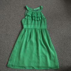 Emmelee Dress Beautiful green stress. Great for summer weddings and summer formal events. 100% polyester. Some signs of wear on the bottom but overall good condition! Emmelee Dresses