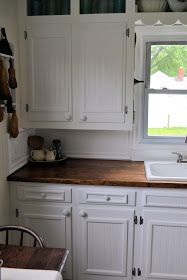 Old cabinets were replaced with beadboard and trim Wall color: Parchment White by Glidden Cabinet color: Pure white Behr