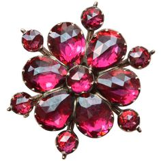 Pyrope Garnet and Gold Flower Brooch | Circa late 19th century http://www.1stdibs.com/jewelry/brooches/brooches/