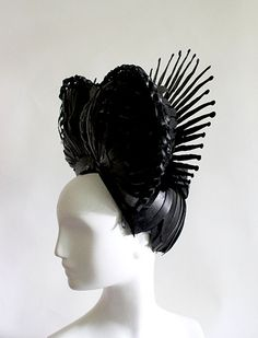 Amy Flurry and Nikki Nye's Paper Wigs for the Victoria & Albert museum. It took a little more than two months to create 16 exquisite paper wigs.