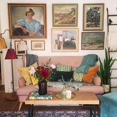 Pink sofa and colorful eclectic decor.