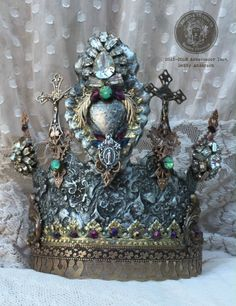 """Crowned in Glory""by Debby Anderson and ""Relic's and Artifacts"" by Sandra Evertson meet!!   I created both of the Crowns for CHA 2016 ~ using the ""Cameos"" and ""Flaming Hearts Ex Voto II"" product resin blanks  http://www.sandraevertson.com/shop/flaming-hearts-ex-voto-ii"