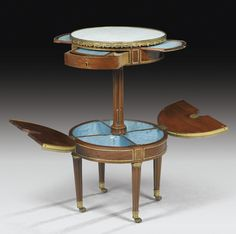 A GILT-BRONZE MOUNTED MAHOGANY AND PLUM-PUDDING MAHOGANY CENTER TABLE ATTRIBUTED TO MARTIN CARLIN, LOUIS XVI, CIRCA 1785