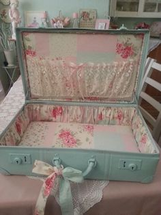 "My 3 vintage suitcases are displayed ""as-is"" but this is a neat idea for totally transforming an old suitcase. #CraftDiva"