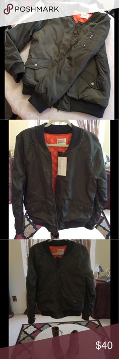 Ashley Bomber Jacket New, Ashley by 26 International Outerwear Bomber Jacket in Olive Green with orange lining ( fully lined). Two pockets snap pockets with a zipper pocket and open pocket on the left upper arm. Size medium Ashley by 26 International Jackets & Coats