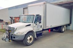 Navistar International 4300 DuraStar series chassis with Morgan Corporation dry van truck body and HTS Systems' HTS-10T Ultra-Rack and HTS-CC Cone Cradle units. HTS Systems' commercial delivery equipment is a safe fleet solution.