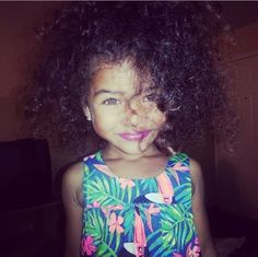 Gorgeous baby girl with tons of curly hair