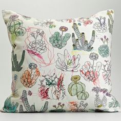 The collection is made up of drawings and paintings which have been scanned and digitally collaged into patterns, and then digitally printed onto 100% pure cotton fabrics using water-based pigment dyes.     So.... this means that I could essentially put anything my son drew on a pillow!!! :D