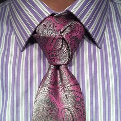 Purple striped shirt, pink paisly tie, trinity knot.