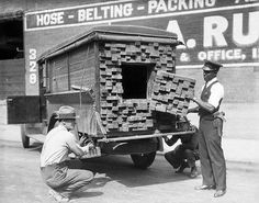 "Policemen inspect a ""lumber truck"" that smelled of alcohol  during prohibition (1926)"