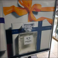 This year's branded theme continues throughout this Chanel Fragrance Ribbon Tied Tower Display. Both fragrances and Ribbon Tie colors vary by panel, but. Tie Colors, Visual Merchandising, Close Up, Fragrance, Tower, Ribbon, Chanel, Display, Tape