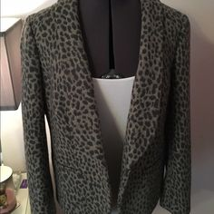 LOFT Leopard Blazer Wool Blend Super chic blazer from Ann Taylor Loft! Leopard print in a soft and warm wool blend material. Silky feeling lining inside. Two faux pockets and one button closure. Two button cuffs. Dress for work without giving up your sense of style! Like new, only wore once. No flaws or marks, perfect condition. Inside still has extra buttons included. Size 12 Petite. LOFT Jackets & Coats Blazers