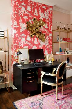 boho glam office with black desk and gold brass glass shelving units