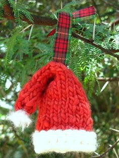 Another hat pattern for the Advent Calendar!  http://naturalsuburbia.blogspot.com/2010/11/knitted-santa-hat-christmas-ornament.html