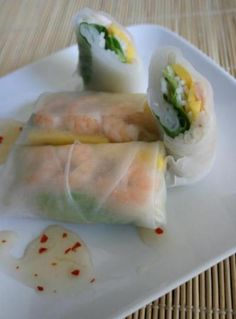 THE ROLLS Spring Wrappers Mango-thin strips Shrimp cook/peel Fresh Basil Lettuce Bean Sprouts Vermicelli or Rice noodles Jalapeño Chili Optional  THE ROLL Adjust ingredients according to taste. Dip the dry wrapper into warm water (one at a time) for about 1-2 mins until soften. Now lay wrappers flat and wipe out excess. Layer the ingredients a little off center and wrap!