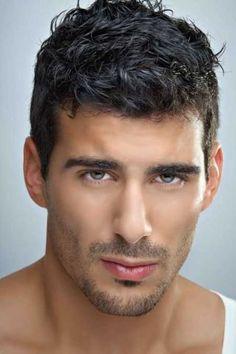 Men's short layered haircut.