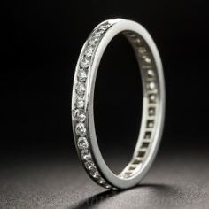 The quintessential wedding band containing thirty-seven channel-set round brilliant-cut diamonds totaling .65 carat. Wear this band alone or with 110-1-1131 in a stack! In a finger size 7 1/4, this ring cannot be resized.